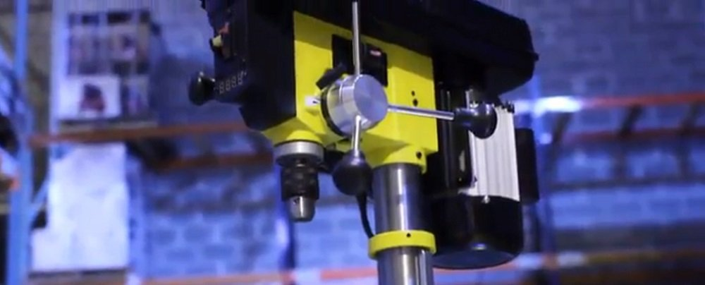 What is the function of a drill press?